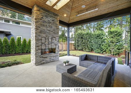 Chic Patio Design With Vaulted Ceiling And Stone Fireplace
