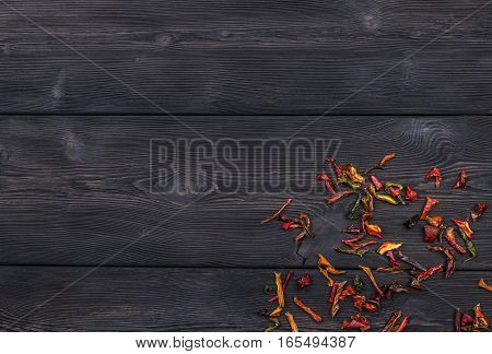dark wooden texture background with dried pepper