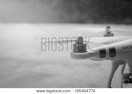 close-up of Rotor drones. Image has shallow depth of field. drone and remote. 4 blade propeller drone. Drone Video Camera. white color drone. Photos drones from Thailand. black and white. drone concept. drone camera.