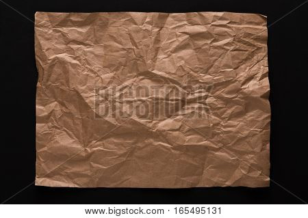old paper isolated on black background. Aged craft obsolete sheet with copy space, vertical