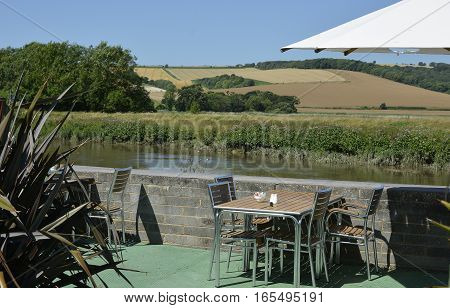 Cafe tables on terrace by River Arun at Amberley West Sussex England