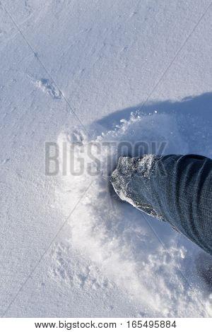 Leg men wading in the snow. Winter.