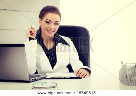 Attractive Businesswoman Working With Laptop At The Office