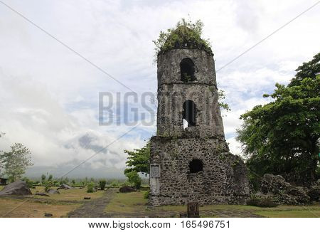 Century old bell tower left standing after the main Church was buried under by volcanic eruption