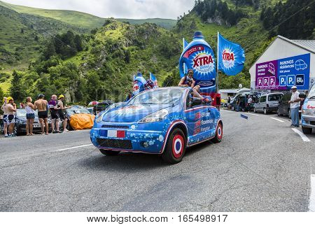 Col du Tourmalet, France - July 24,2014: X'tras caravan during the passing of the Publicity Caravan on the road to Col de Tourmalet in the stage 18 of Le Tour de France 2014.