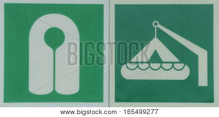White life vest and lifeboat symbols on a green background
