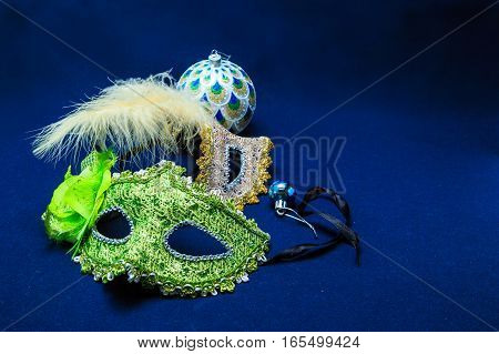 Theatrical masks with ornaments against a dark background