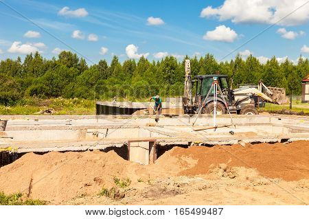 NOVGOROD REGION RUSSIA - JULY 1 2016: View of construction site and house foundation in preparation process in summertime