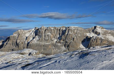 Stone cliff of Dolomite Alps in front of blue sky in Madonna di Campiglio place. Italy