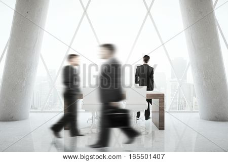 Blurry businesspeople walking in modern office. Close up.