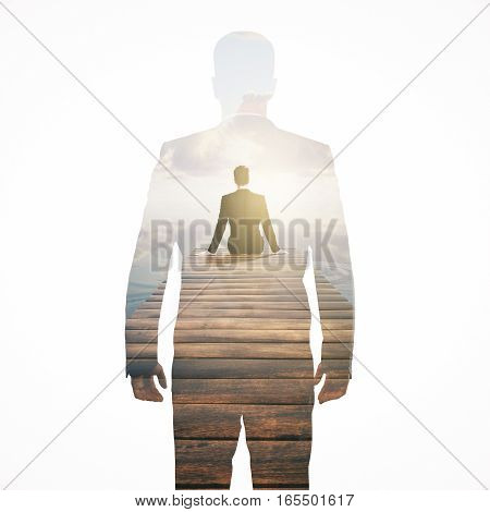 Back view of thoughtful man sitting on pier and looking into the distance. Research concept. Double exposure