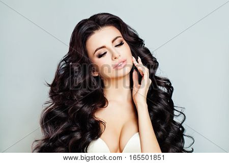 Sexy Model Woman. Makeup Long Curly Hair Eyes Closed
