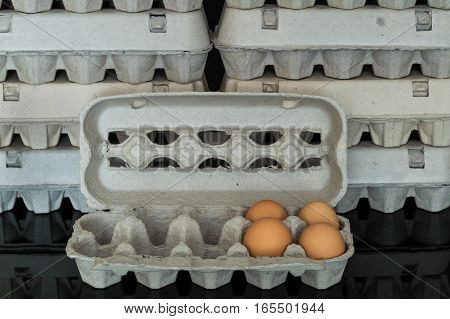 Egg Box With Four Organic Chicken Eggs Inside