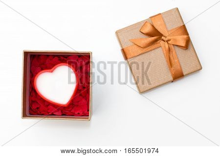 heart in open gift box with lots of little hearts on a white background. festive flat lay concept for Valentine's day birthday wedding party holiday
