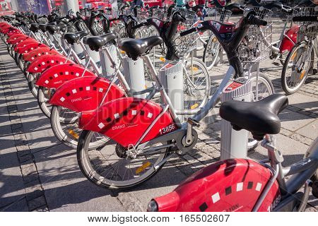 LYON FRANCE - on APRIL 15 2015 - Shared bikes are lined up in the streets of Lyons France. Velo'v Grand Lyon has over 340 stations and 3000 bikes throughout the Grand Lyon area.