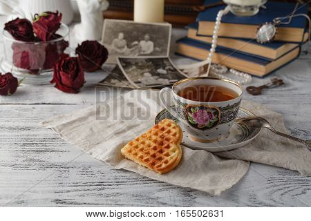 Family memories with cup of tea on table