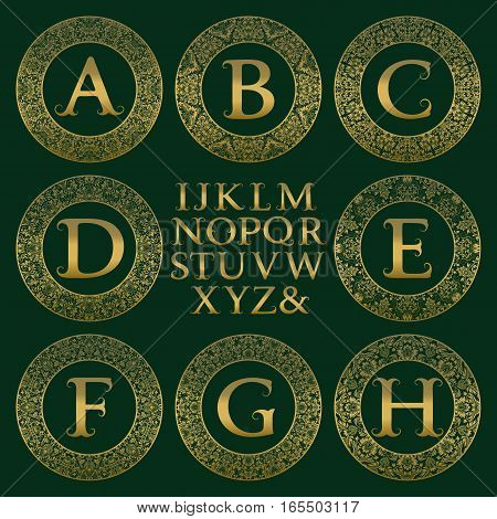 Vintage monogram kit. Golden letters and floral round frames for creating initial logo in antique style.