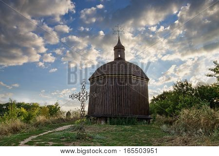 an old chapel and a cross in the village vitachov near Kiev