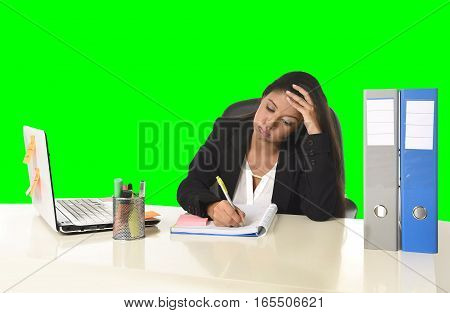 young beautiful latin business woman suffering stress working at office computer desk looking worried and desperate having problem at work isolated green chroma key background