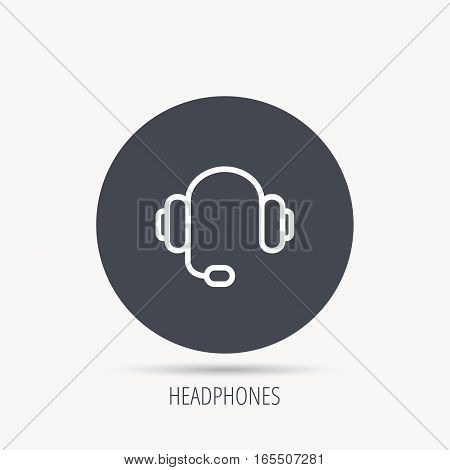 Headphones with microphone icon. Musical notes signs. Round web button with flat icon. Vector