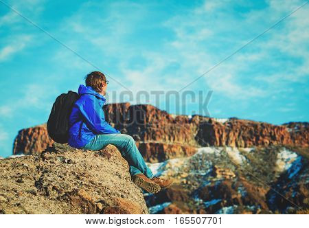 Hiker looking at view of volcano Teide, Tenerife, travel concept