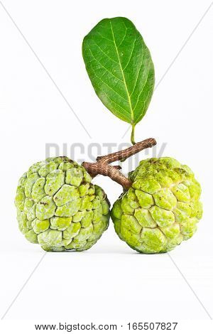 Two Custard apple fruits on white background
