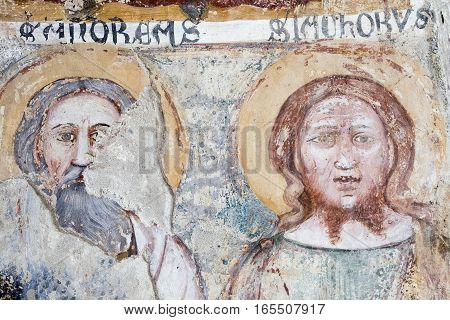 AGLIATE, ITALY - NOVEMBER 1, 2016: Agliate Brianza (Monza Lombardy Italy): interior of the medieval church of Saints Peter and Paul built from the 11th century Baptistery medieval painting by anonymous artist