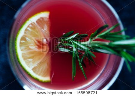 Cranberry Juice in Glass with Fresh Rosemary