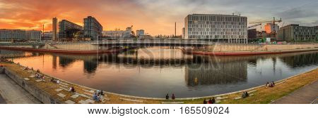 Panoramic view of Berlin skyline and river at sunset