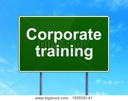 Studying concept: Corporate Training on green road highway sign, clear blue sky background, 3D rendering