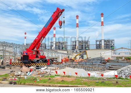 Mobile Crane Against Demolition Site Or Construction Site Of Power Plant Background