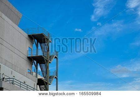 Fire escape of building against clear sky