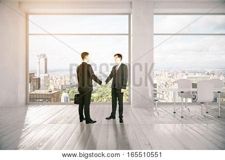 People Shaking Hands In Meeting Room