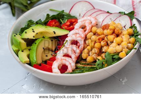 Healthy green salad with avocado and shrimp. Love for a healthy food concept