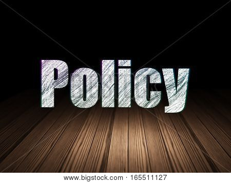 Insurance concept: Glowing text Policy in grunge dark room with Wooden Floor, black background