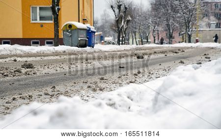 Empty snowy road in city with no cars