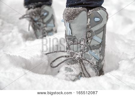 Grey hiking boots walking outside in the snow