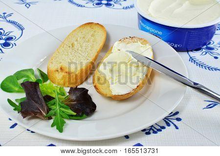 Honey-vanilla mascarpone spread on toast topped with fresh greens.
