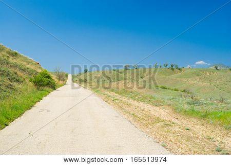 Empty road in Eastern Crimea at spring season.