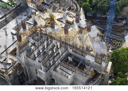 Arial view of construction site and construction worker