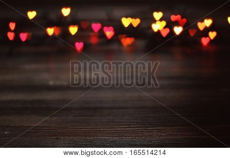 variegated heart bokeh, Valentine's day concept on wooden background