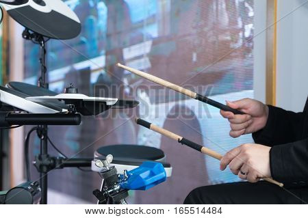 Musical Instruments And Entertainment Concept - Close Up Of Man Playing On Electronic Drum Kit.