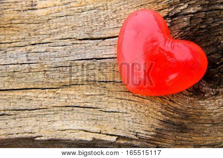 Heart shaped soap on the wooden background