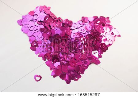 Confetti In The Shape Of Hearts Scattered On The Table