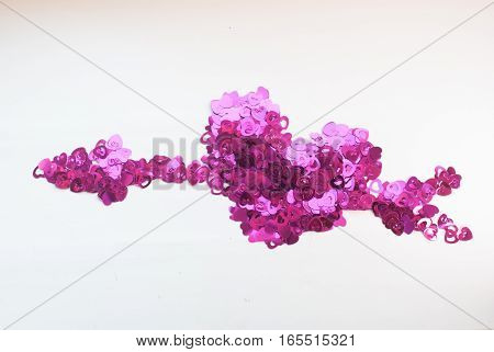 Confetti In The Shape Of Hearts Scattered On A White Table