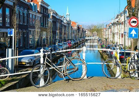 street and canal view, dutch houses and bicycles in Delft, Holland