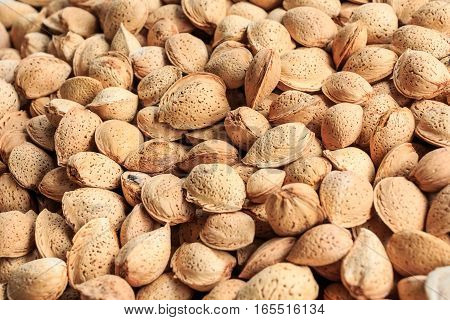 Background made of close-up image of walnuts at marketplace