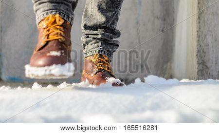 A man walks in the snow. Winter walks concept
