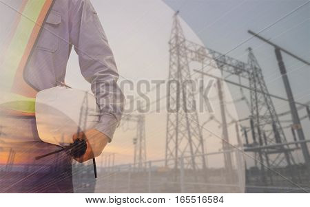 Double Exposure Mechanical Engineer Or Civil Engineer Against Blurred Power Plant Background