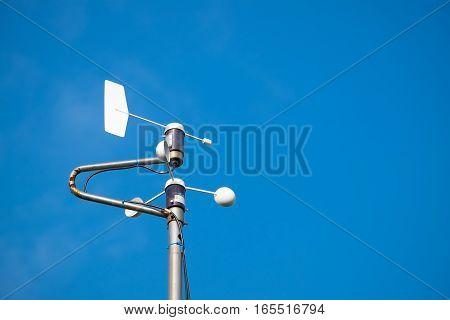 Weather station against blur sky with copyspace
